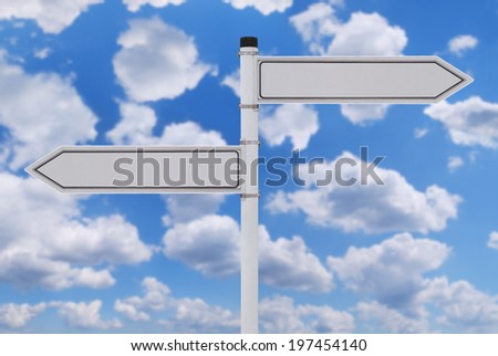 Blank signpost over blue sky with clouds - stock photo