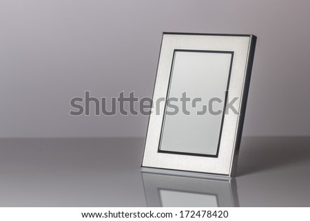 Blank silver picture frame at the desk - stock photo