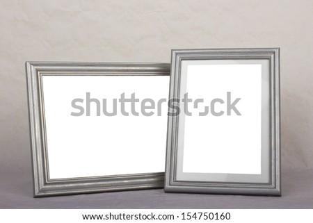 Blank silver picture frames on gray background - stock photo