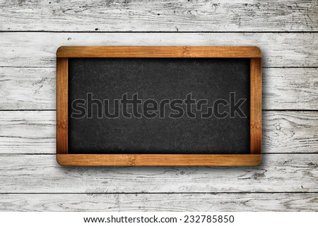 Blank Slate as Copy Space on White wooden planks pattern texture as background - stock photo