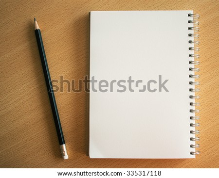 Blank space on notebook page for creative background and wording. dark tone image.