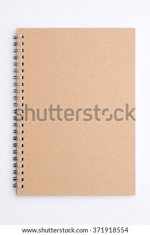 blank spiral brown notebook on white background - stock photo