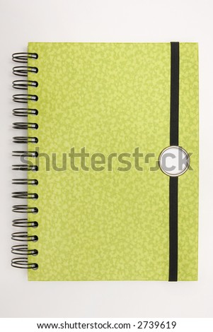 Blank spiral design notebook ready for writing - stock photo
