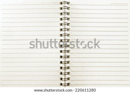 Blank spiral notebook with line paper - stock photo