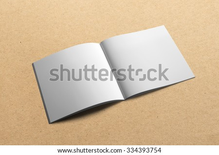 Blank square, brochure magazine isolated on cardboard background, with clipping path, changeable background - stock photo