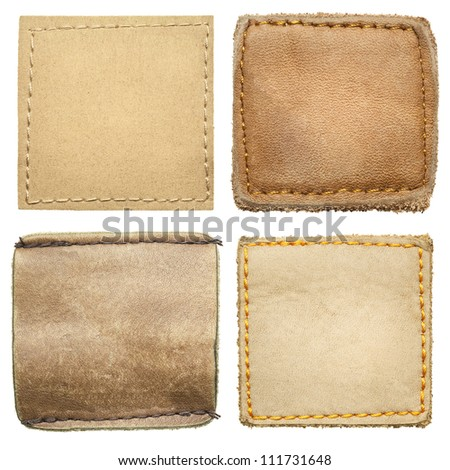 Blank square shape leather jeans labels. - stock photo