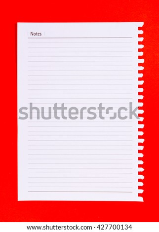 Blank stack white note paper on red background.