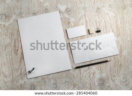 Blank stationery and corporate identity template on light wooden background.  Mock-up for graphic designers portfolios. Top view.  - stock photo