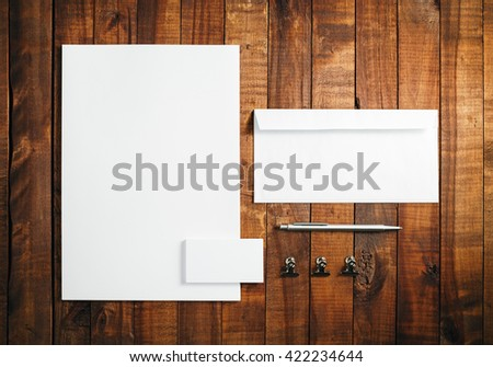 Blank stationery and corporate identity template on vintage wooden background. Letterhead, business cards, envelope and pen. Mock-up for branding identity. Top view. - stock photo