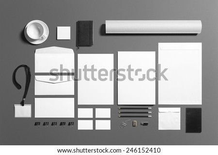 Blank stationery branding set isolated on grey. Consist of folder, note, business cards, pencil, dvd disk, money clips, envelopes, tubus. - stock photo