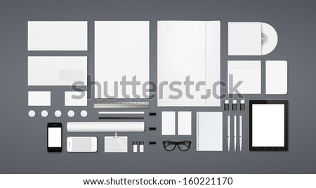 Blank Stationery Corporate ID set isolated on grey. Consist of Business cards, A4 letterheads, Folder, Tablet PC, envelopes, tube, phones, tablet, disk and notebook. - stock photo