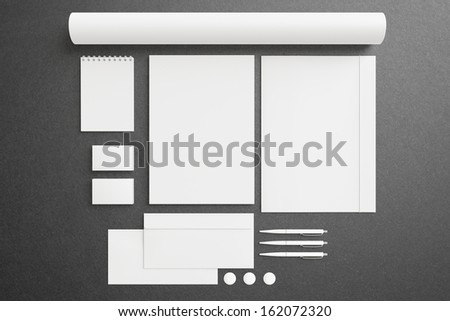 Blank Stationery Corporate ID set on dark background with soft shadows. Consist of Business cards, A4 letterheads, envelopes, business cards, notebook, tube, pens and folder. - stock photo
