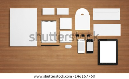 Blank Stationery Corporate ID Template on wooden background with soft shadows. Consist of Business cards, A4 letterheads, Folder, Tablet PC, envelopes and notebook. - stock photo