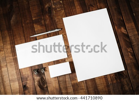 Blank stationery set. Blank corporate identity template on vintage wooden table background. Blank letterhead, business cards, envelope and pen. Mock-up for branding identity. - stock photo