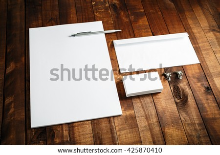 Blank stationery set. Corporate identity template on wooden table background. Letterhead, business cards, envelope and pen. Mock-up for branding identity. - stock photo