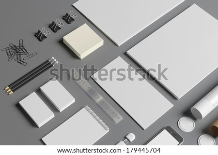 Blank stationery set isolated on grey. Consist of folder, note, business cards, pencils, envelopes, tubus. - stock photo