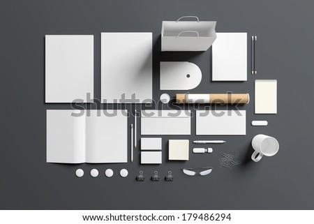Blank stationery set isolated on grey. Consist of folder, note, magazine, bag, business cards, pencil, cd disk, buttons, envelopes, tubus. - stock photo