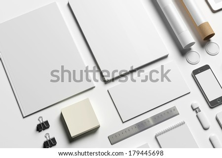 Blank stationery set isolated on white. Consist of folder, note, letterheads, flash disk, envelopes, tubus. - stock photo