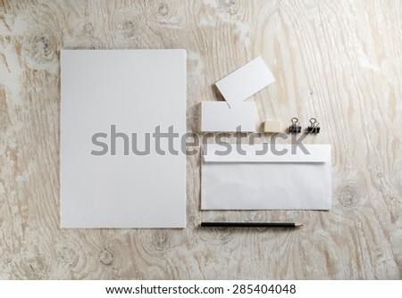 Blank stationery set on light wooden background. Template for ID. - stock photo