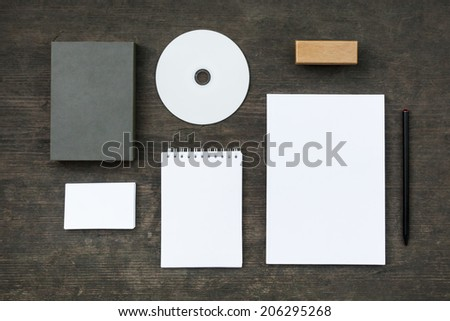 Blank stationery set on old wood background: business cards, booklet, sheets, notebook, stamp, CD, and box. Retro style - stock photo
