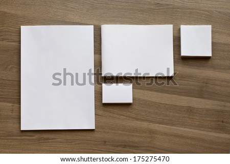 Blank stationery set on wood background / a4 paper, business cards, booklet, etc - stock photo