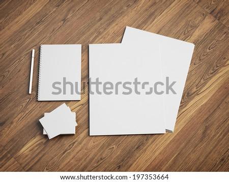 Blank stationery set on wood desk - stock photo