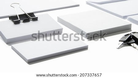 Blank stationery with clipping path isolated on white to replace your design