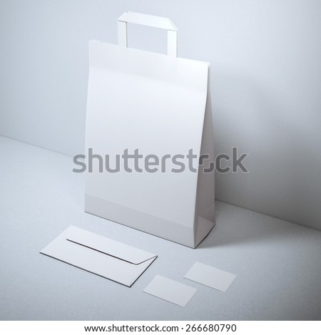 Blank stationery with paper bag - stock photo