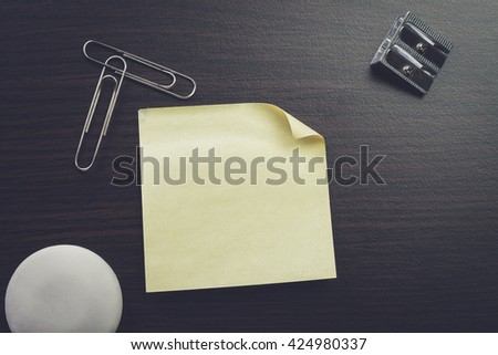 blank sticker and stationery on brown table