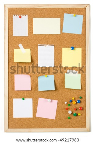 Blank sticky notes pinned on cork notice board