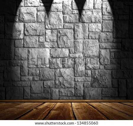 Blank stonewall with 3 spotlights and wooden floor - stock photo