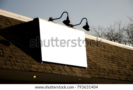 Blank store sign with light fixtures. Customize with your text.