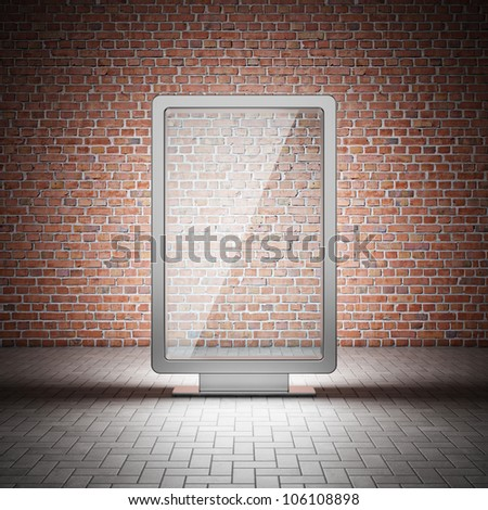 Blank street advertising billboard and brick wall at night