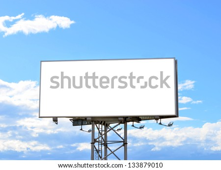 Blank street billboard against blue sky - stock photo