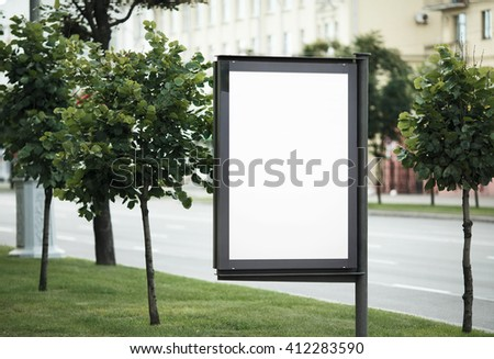 Blank street poster. Blank billboard on the city street. Isolated with clipping path. Shallow depth of field. Selective focus. - stock photo