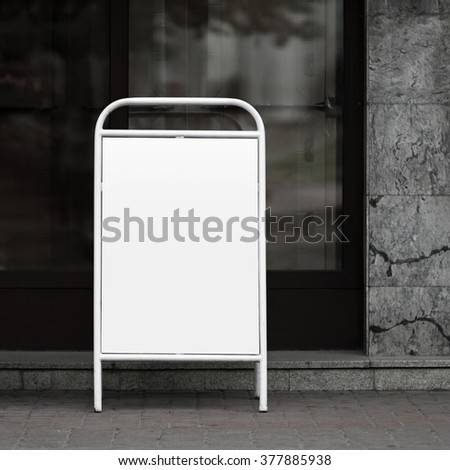 Blank street poster - clamshell in white painted steel frame. Clipping path. - stock photo