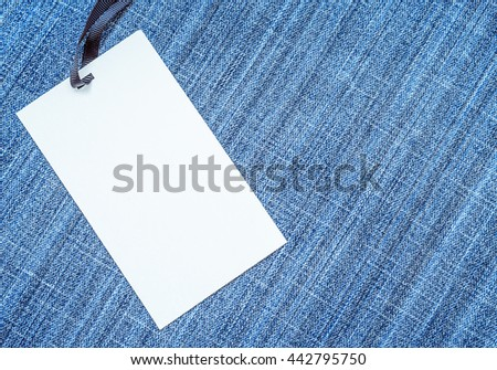 blank tag on blue jeans background - stock photo