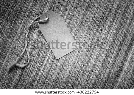 Blank tag on blue jeans textile background - stock photo