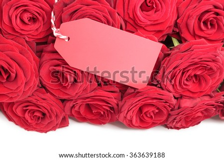 Blank tag on red roses bouquet on white background - stock photo