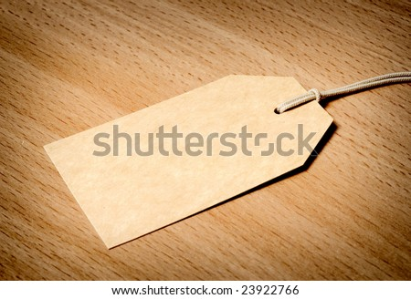 Blank tag on wooden background - stock photo