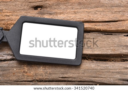 blank tag on wooden table - stock photo