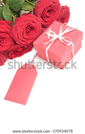 Blank tag, red gift box and red roses isolated on white background - stock photo