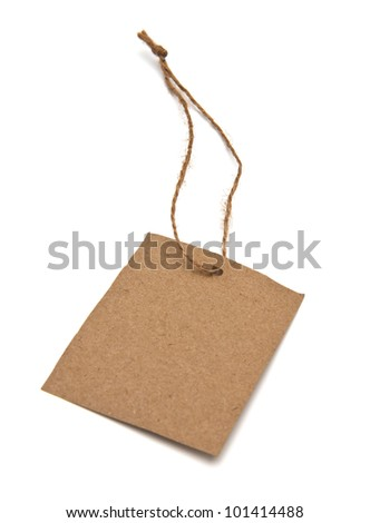 Blank tag tied with brown string. - stock photo