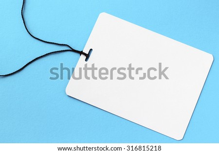 Blank tag tied with string. Price tag, gift tag, sale tag, address label - stock photo