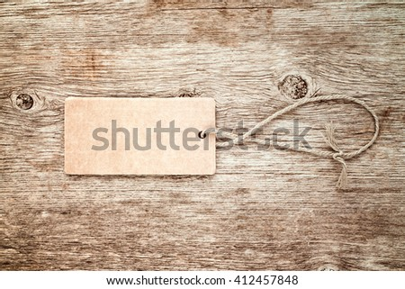 Blank tag tied with string. Price tag, gift tag, sale tag or address label. - stock photo