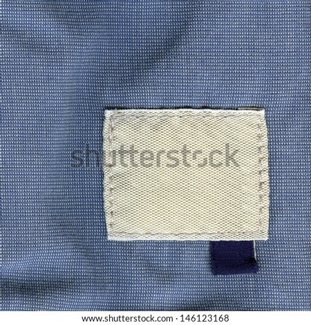 Blank textile textured label.  Fragment of texture with pure label for your text.  - stock photo