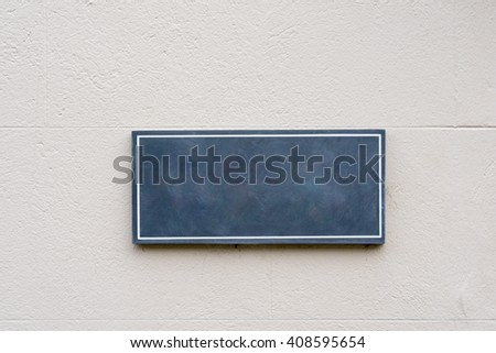 Blank tile on a wall for your text, conceptual image - stock photo