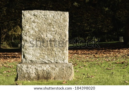 Blank Tombstone in Cemetery - stock photo