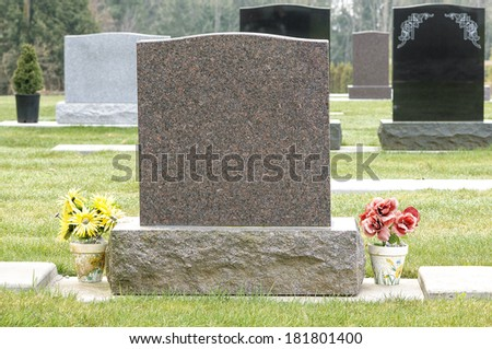 Blank Tombstone with Flowers - stock photo