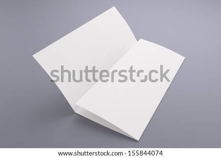 Blank tri fold brochure isolated on grey to replace your design or message - stock photo